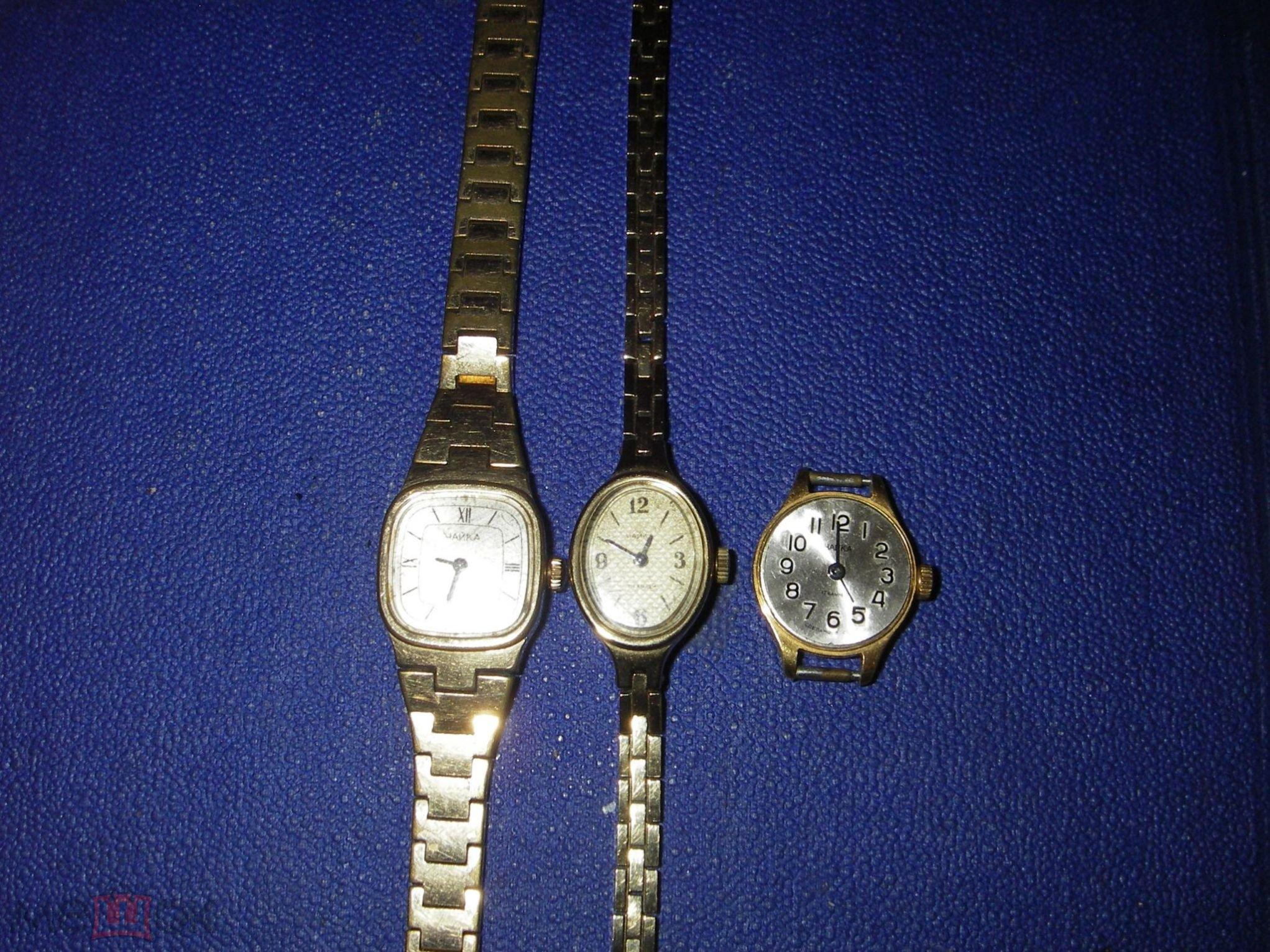 Женские золотые часы на браслете чайка